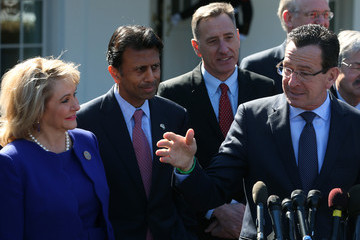 Connecticut Gov. Dan Malloy responds to Louisiana Gov. Bobby Jindal (second from left) at White House press conference. (Getty)